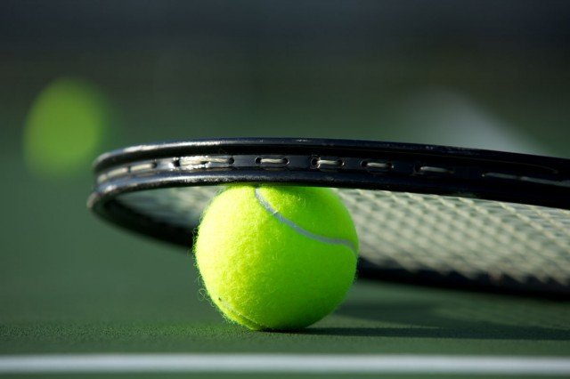 tennis-racquet-on-ball-shutterstock_112190813-640x426